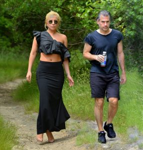 EXCLUSIVE: Lady Gaga maintains her personal style during a hike in the woods with her new boyfriend Christian Carino