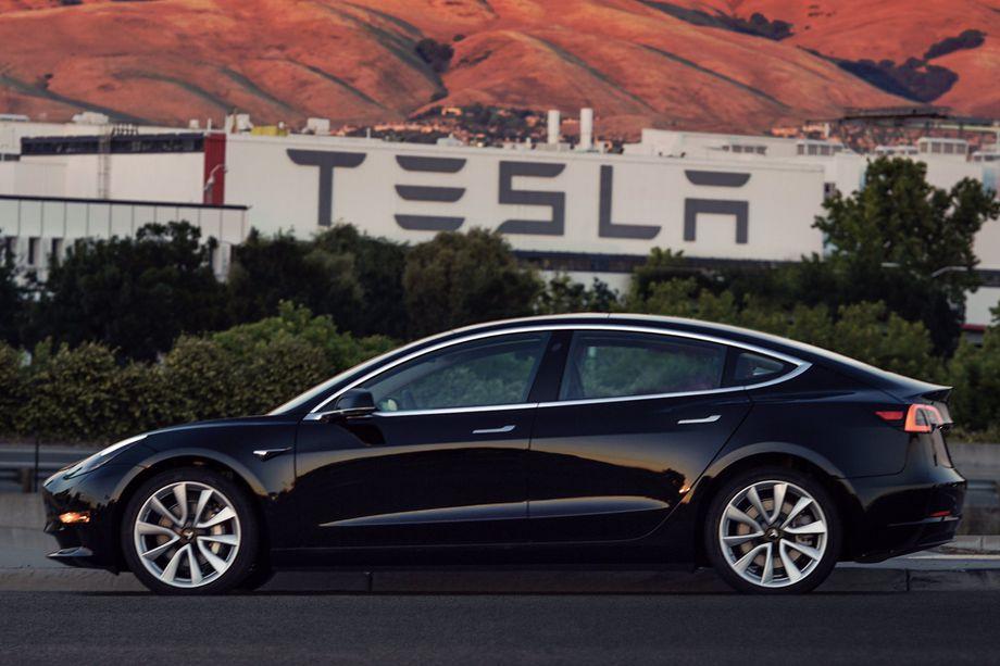 Elon Musk Unveils First Glimpse of Tesla Model 3