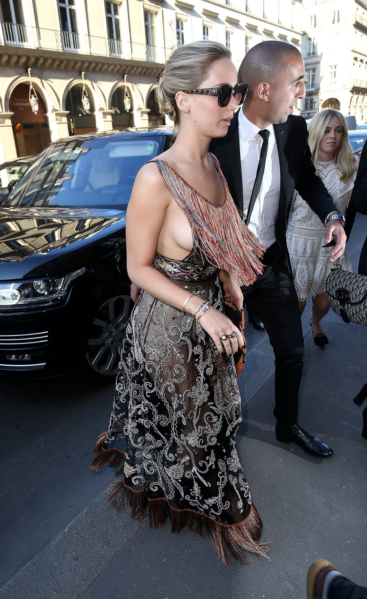 Jennifer Lawrence Sports Sideboob and Boxers While out in Paris