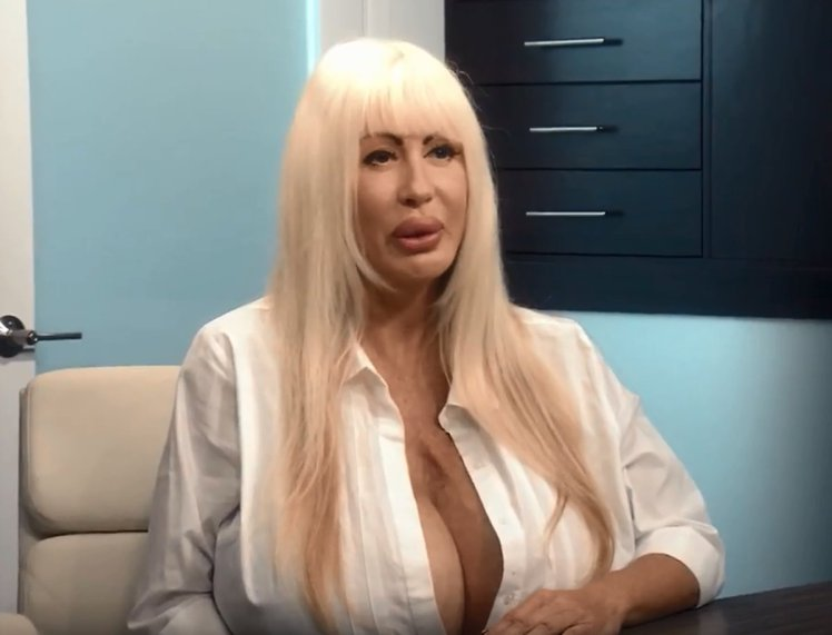 Porn star seeks help after O-cup breasts start 'leaking'