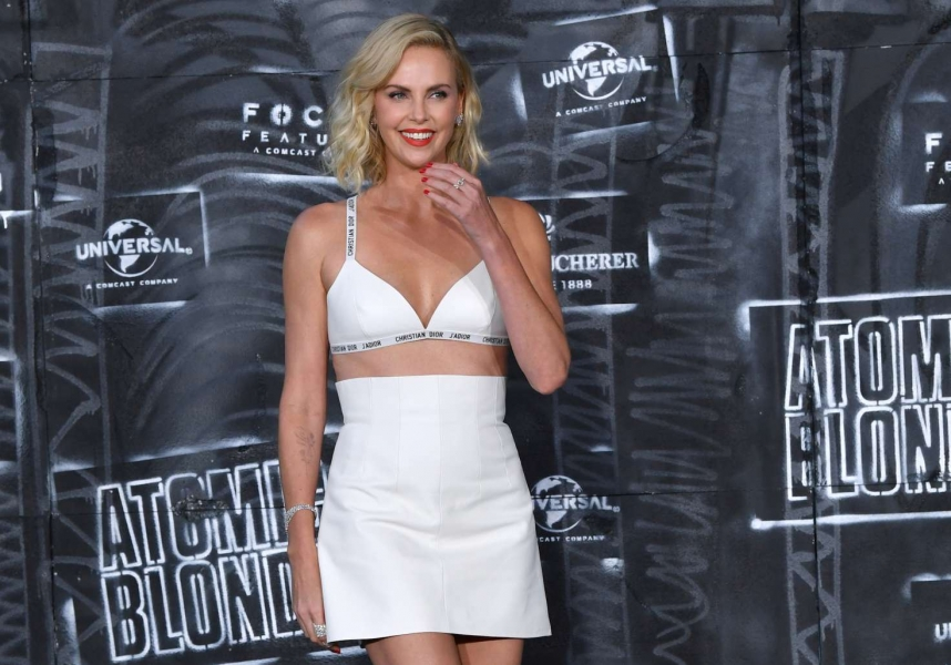 Charlize Theron Wears Nothing but a Bra and a Miniskirt on the Red Carpet