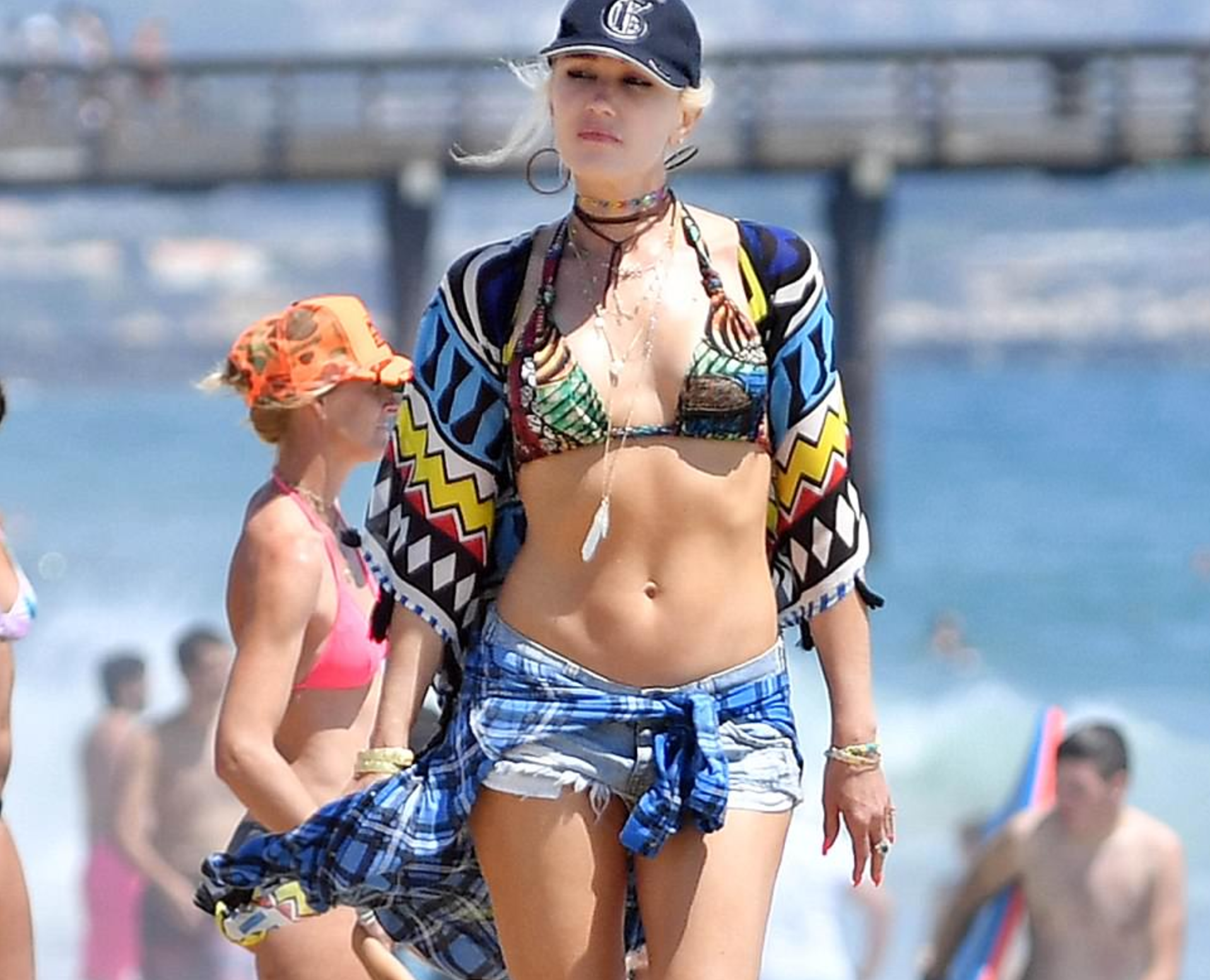 Gwen Stefani Hits the Beach in Vibrant Bikini and Teeny Daisy Dukes