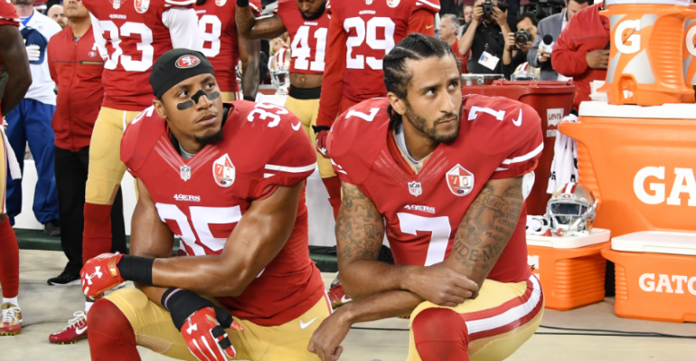 Should the NFL require players to stand during the National Anthem?