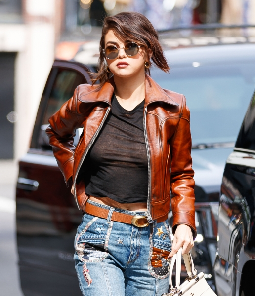 Braless Selena Gomez Steps out in a Thin Black T-Shirt