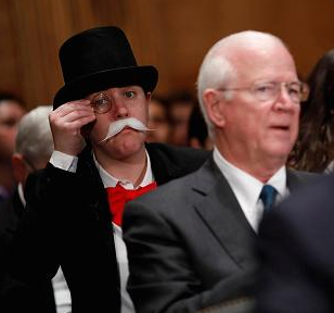 Woman Dressed Up as 'Monopoly Guy' Photobombs Senate's Equifax Hearing