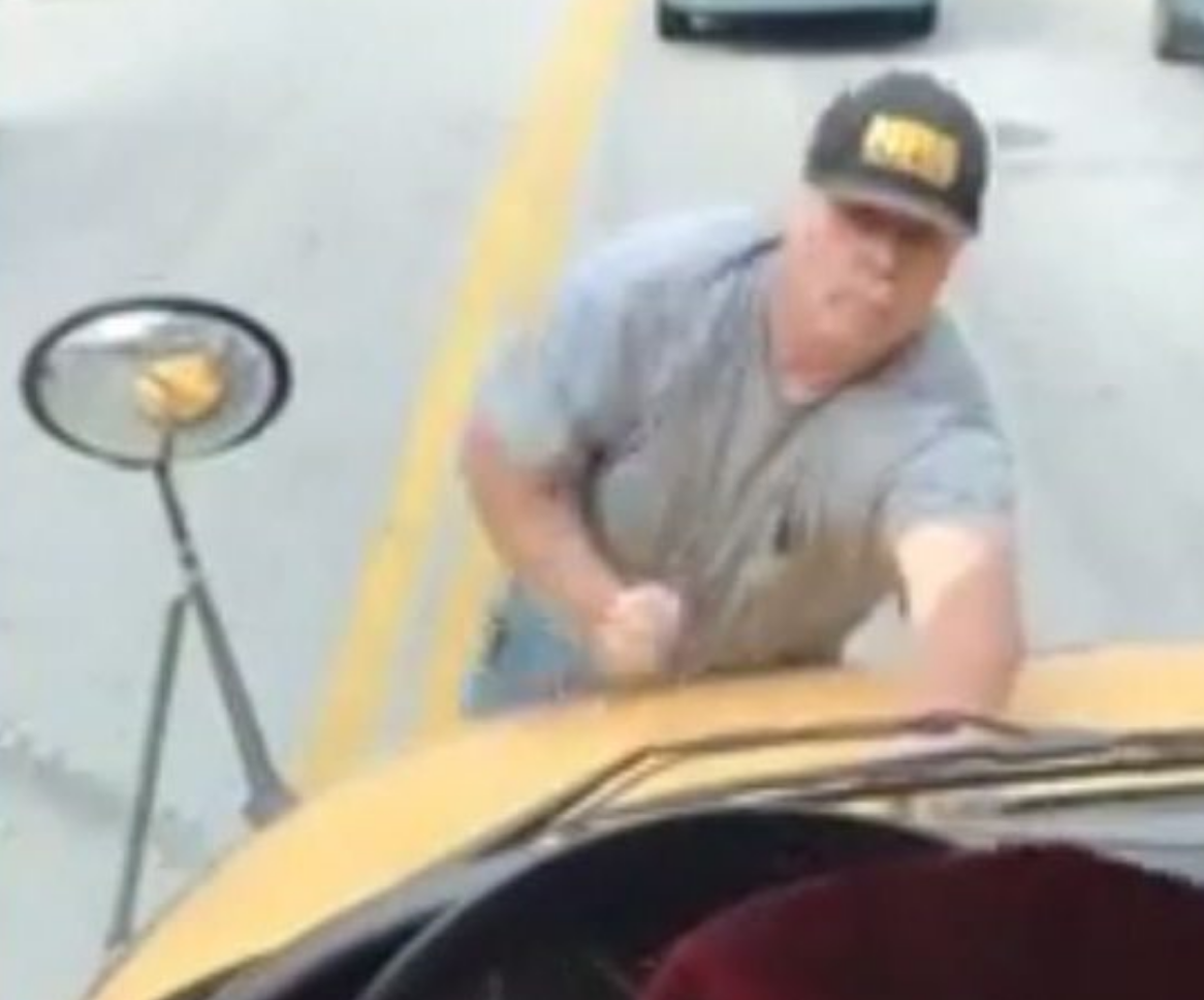 Angry Man Hangs Onto Front of Schoolbus to Shout at Students