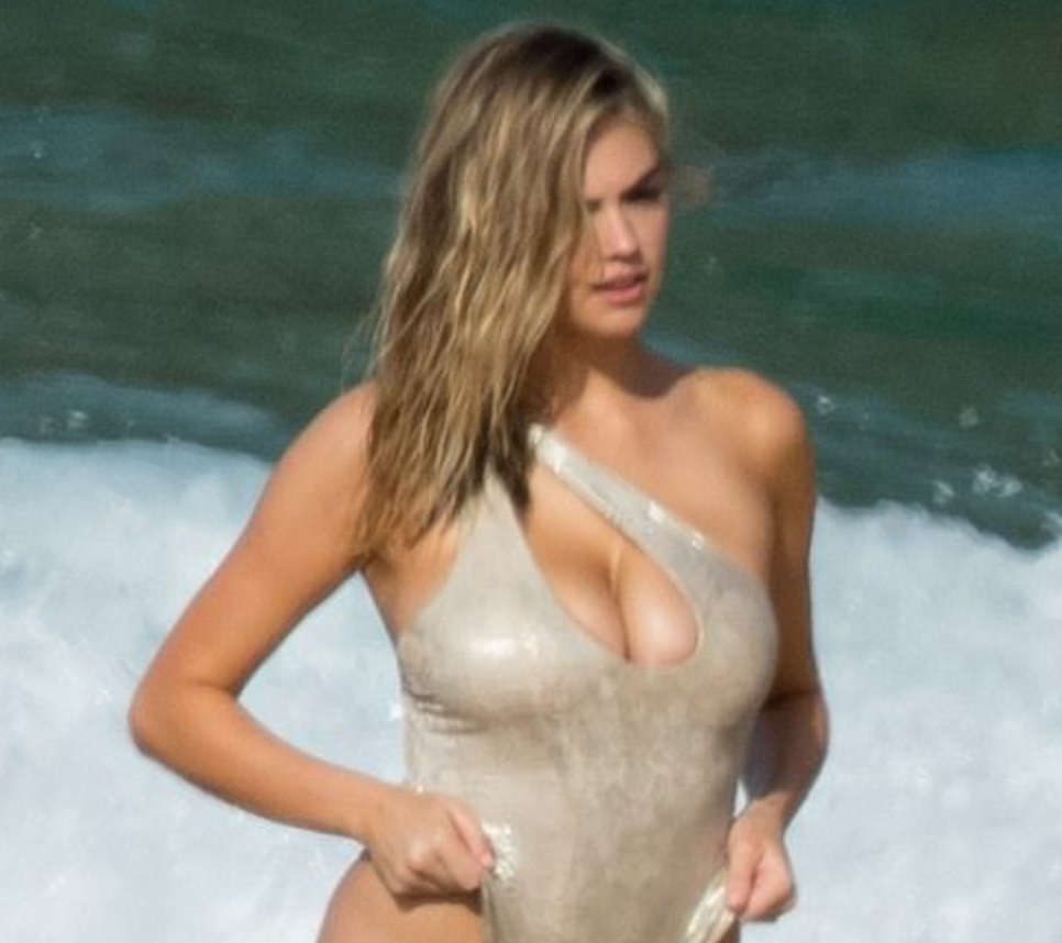 Kate Upton Hikes Up Her Cleavage-Baring Swimsuit on the Beach for SI [PICS]