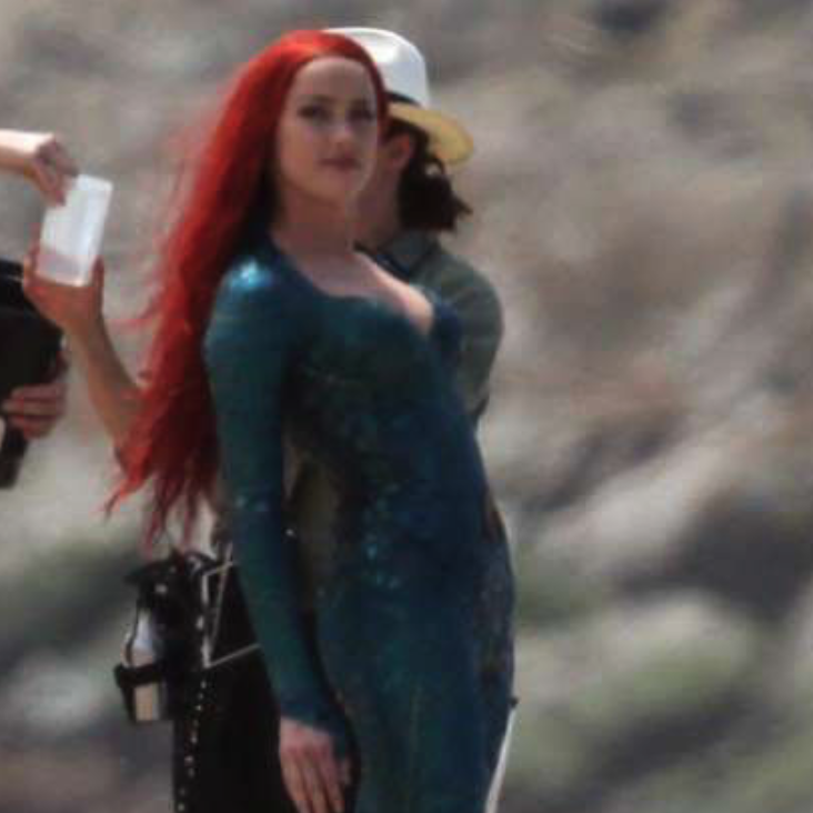 Amber Heard Gets Drenched While Showing Cleavage on the AQUAMAN Set