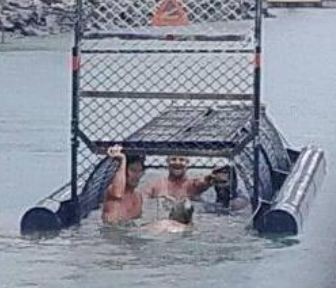Men Photographed in Baited Crocodile Trap Branded 'Idiots of The Century'