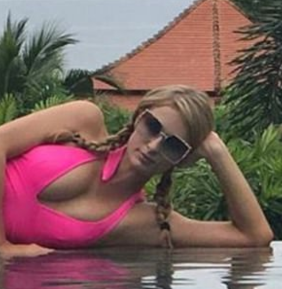 Paris Hilton Looks Like a Pinup in a Plunging Pink Bathing Suit