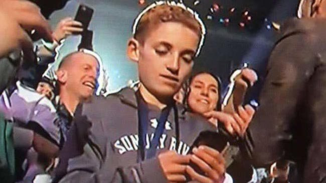 This Kid Looking at His Phone During Justin Timberlake's Super Bowl Halftime Show Is Now a Meme