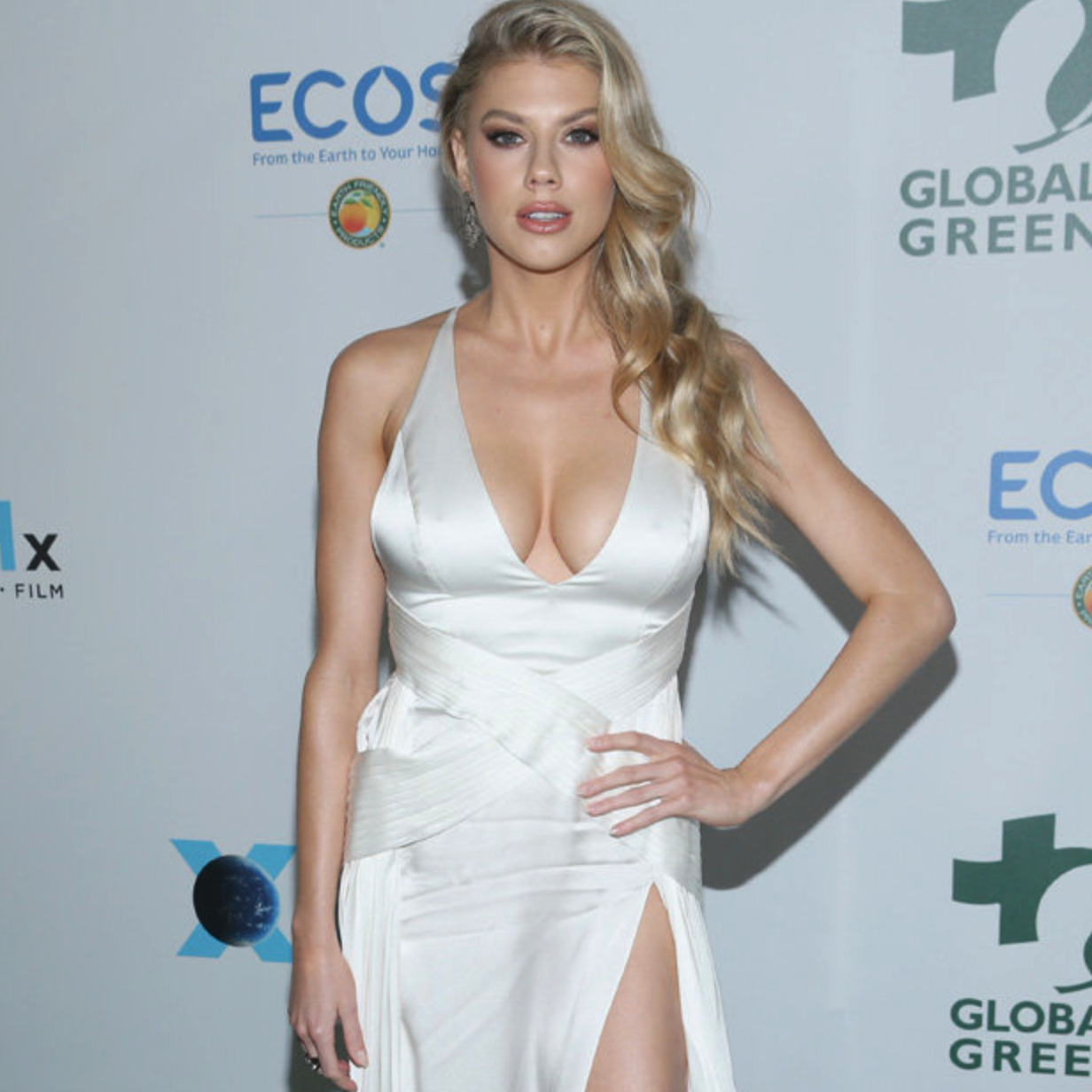 Charlotte McKinney Unleashes Her 32F Assets in Revealing Plunging Dress [SFW PICS]