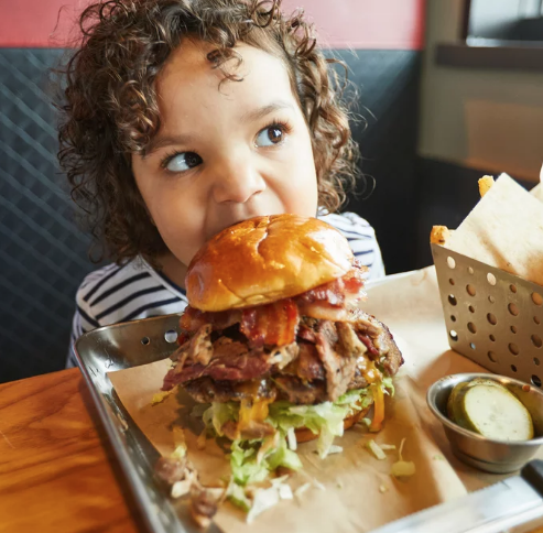 Chili's Debuts a 1,650-Calorie Burger Topped with Sausage, Ribs, Bacon, Brisket, and More