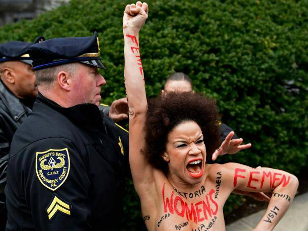 Topless Bill Cosby Protester Is an Actress Who Appeared on THE COSBY SHOW [SFW PIC]