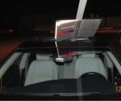 Would You Know It If A Road Sign Were Sticking Out Of Your Car's Sunroof?