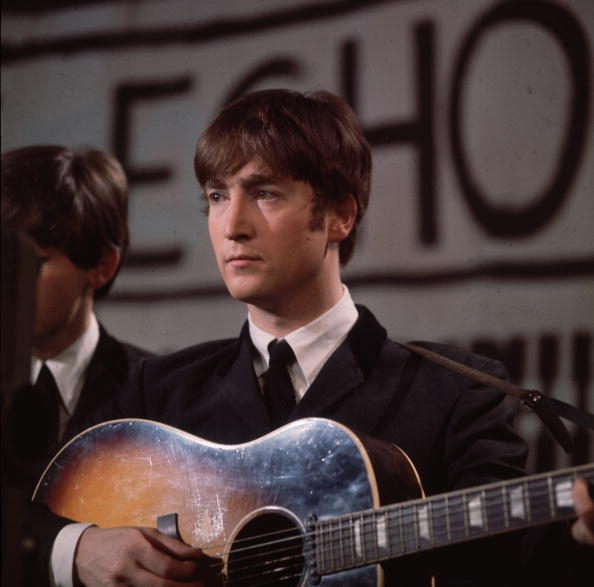 John's Acoustic guitar Brings Big Bucks...