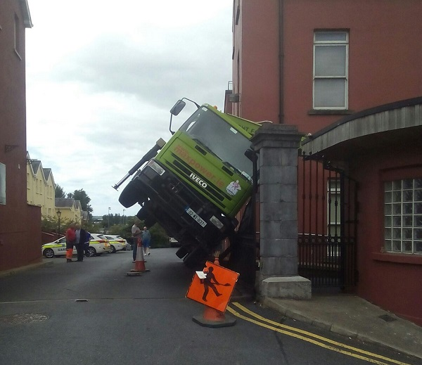 Man injured after truck overturns in Waterford