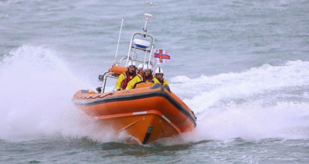 Helvick Lifeboat assists in bringing crewman to safety.