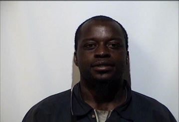 Man allegedly broke into motel room, assaulted woman