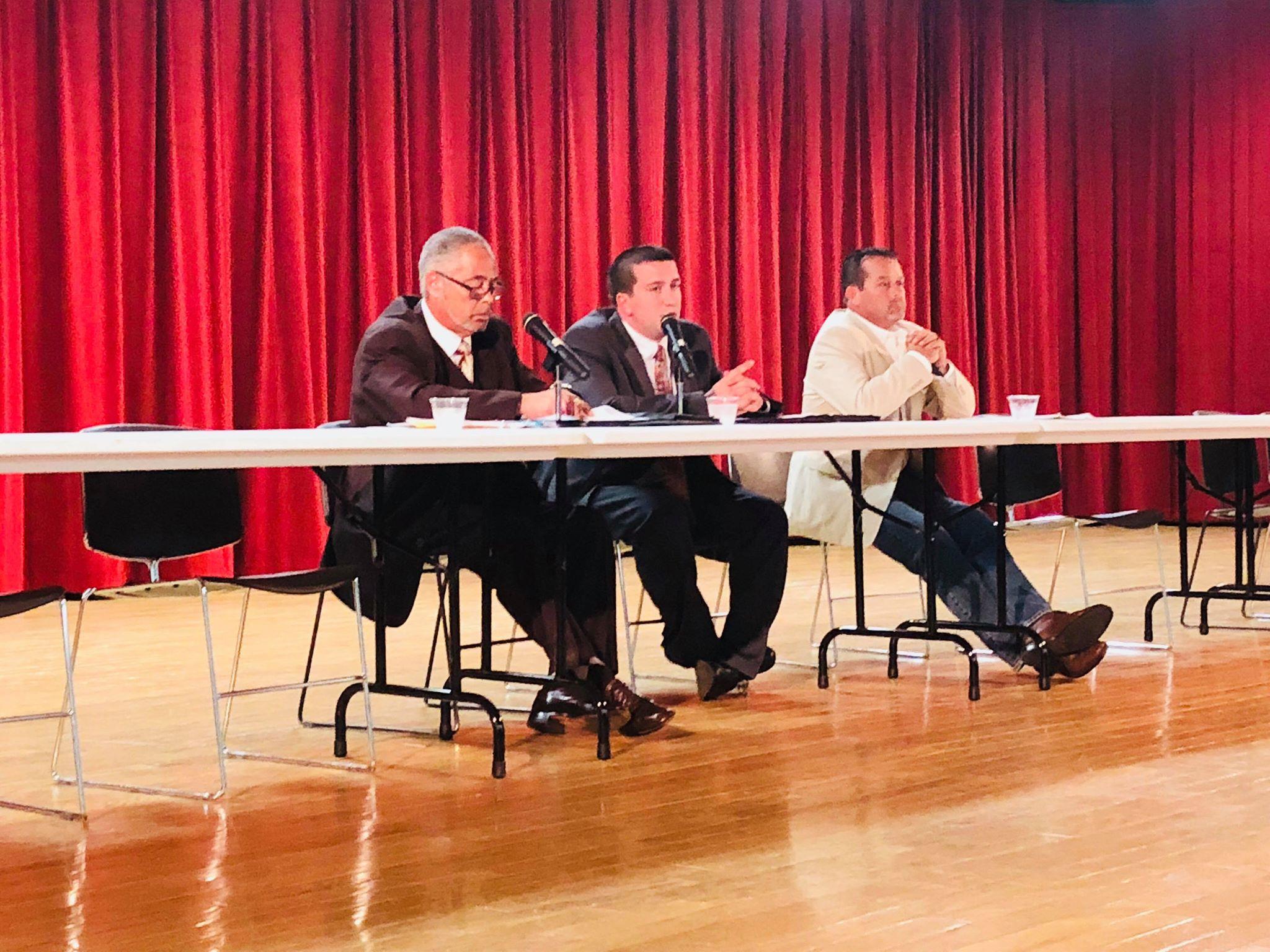 Coroner candidates face off at Focus 21st Century forum