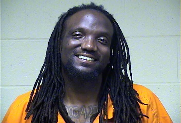 Report: Man slammed girlfriend against car in Guthrie