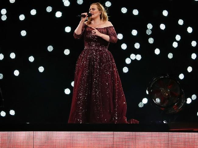 Adele joked that her fan, seen next to her, was not as impressive as Beyonce's. Picture: Cameron Spencer/Getty ImagesSource:Getty Images