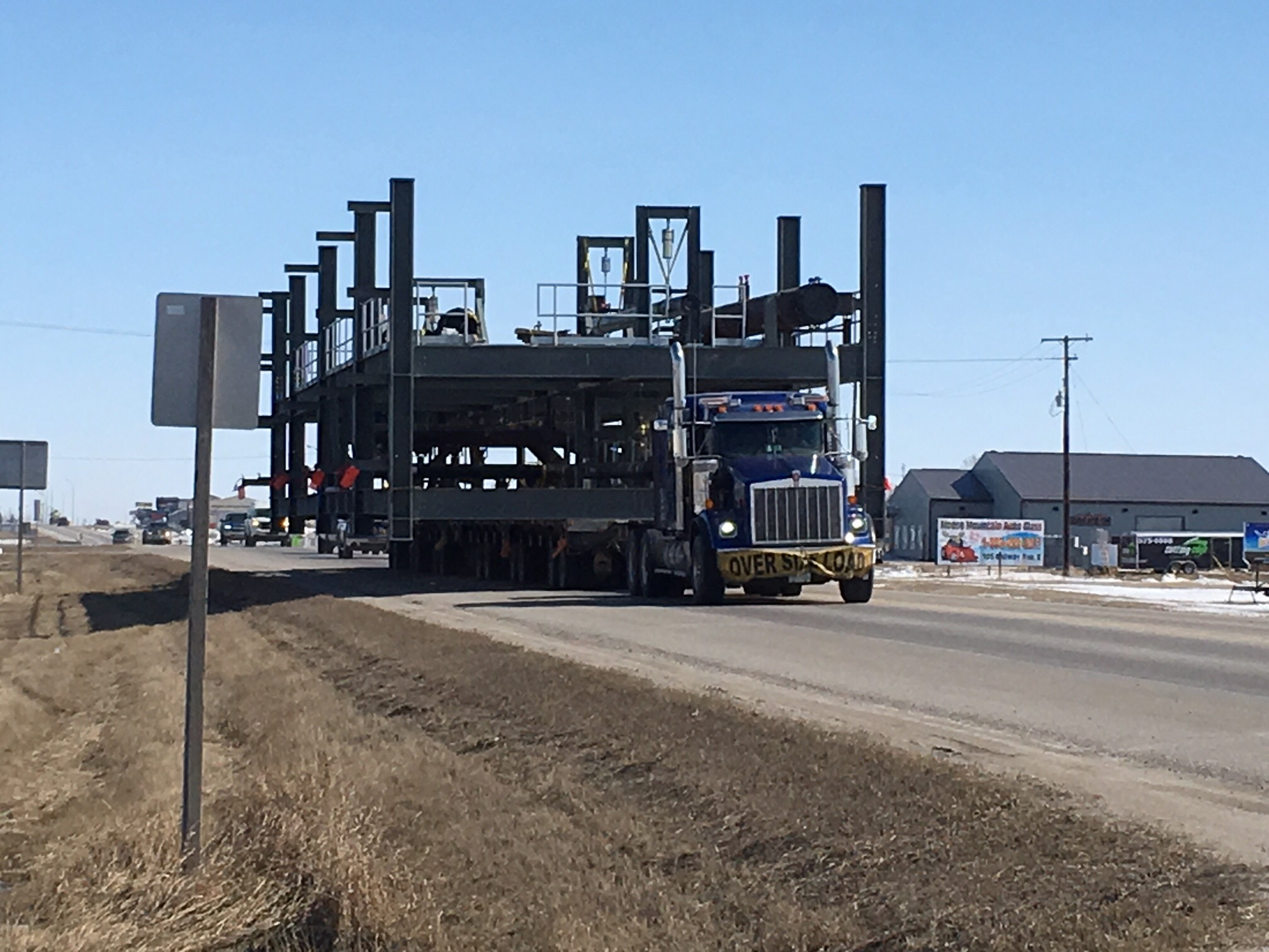 Large Transport Continues its Slow Move in Southern Saskatchewan