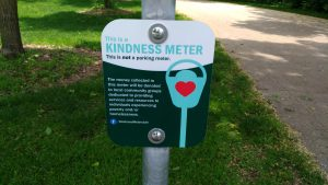 A small sign attached to every Kindness Meter