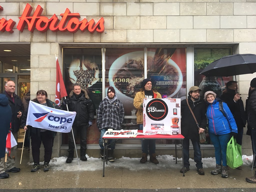 Protest outside downtown London Tim Hortons sparked by employee benefits cuts