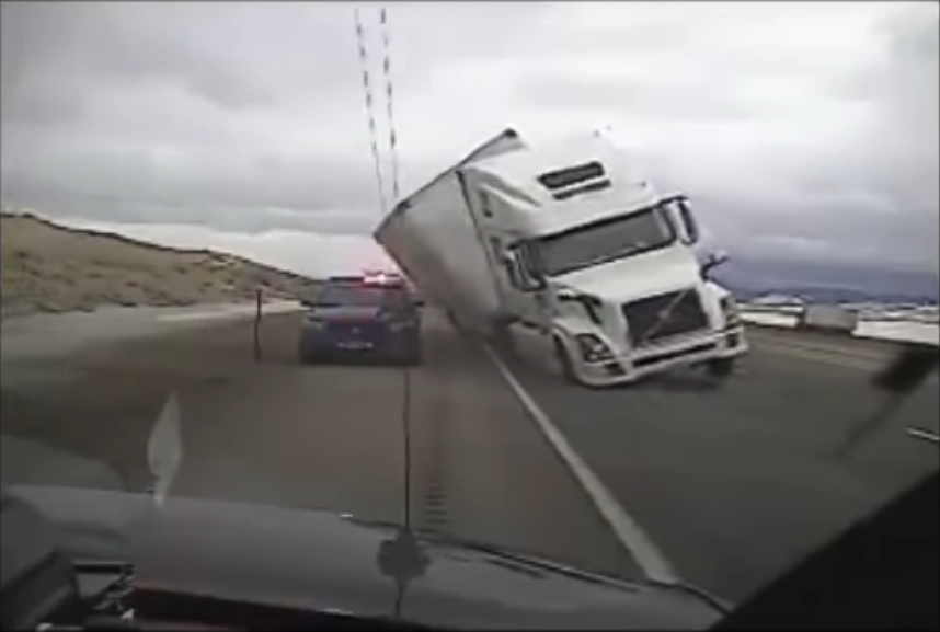 Semi Truck Crushes Patrol Car (Video)