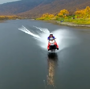 Watch Guy Set World Record Riding A Snowmobile Across A Lake. Yes. A Snowmobile On Water