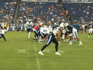Nashville TN – August 5, 2017 – Nissan Stadium – Titans quarterback Marcus Mariota (in red) sends tight end Delanie Walker (#82) in motion during an intra-squad scrimmage (Photo by Buck Reising, ESPN Nashville).