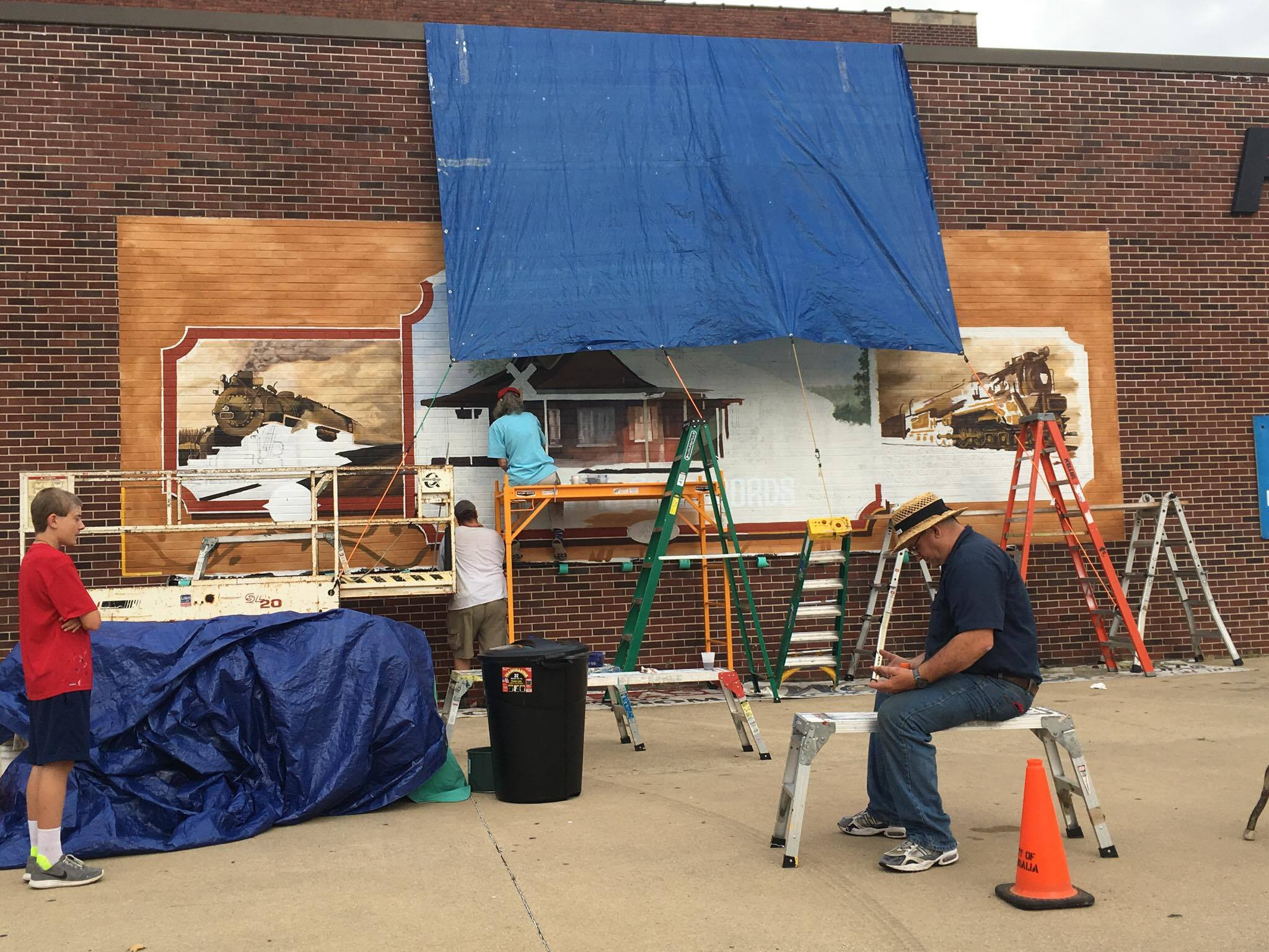 "Downtown Mural work continues with ""Little Toot"" giving rides to Children"