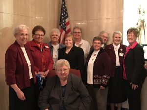 To recognize their contributions, HSHS St. Anthony's Memorial Hospital recently honored local Sisters on March 8 during the hospital's daily Mass in their Chapel, followed by a luncheon in the hospital Board Room. Those who participated in the celebration included (standing, left to right) Sister Jane Marie Hotze, SSND – Presence and Prayer, Volunteer Service to Effingham Parishes; Sister Sandra Sudkamp, OSF – Food Coordinator, Effingham Catholic Charities; Sister Pat Thies, SSND – Presence and Prayer, Volunteer Service to St. Michael the Archangel Church in Sigel, St. Mary Help of Christian's Church in Green Creek, Sacred Heart Church in Lillyville, and St. Mary's Church in Neoga; Sister Rene Simonelic, OSF – Liturgist, Sacred Heart Parish, Effingham; Sister Ann Pierre Wilken, OSF – Faith Formation Director, St. Francis Parish, Teutopolis; Sister Carol Beckermann, OSF – Director of Effingham Catholic Charities; Sister Ann Vincent Siemer, SSND – Elementary Faith Formation Coordinator, St. Francis Parish, Teutopolis; Sister Jane Boos, SSND – Pastoral Care, HSHS St. Anthony's Memorial Hospital; Theresa Rutherford – President and CEO, HSHS St. Anthony's Memorial Hospital; and (seated) Sister Kathleen Bushur, OSF – Prescription Medicine, Effingham Catholic Charities.