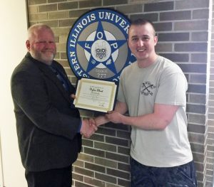 FOP State Lodge President Chris Southwood, left, presents the FOP Life Saving Award to Eastern Illinois University Police Officer Dylan Short.