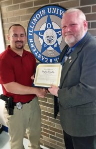 EIU Police Officer Stephen Szigethy, left, receives the FOP Meritorious Service Award from FOP State Lodge President Chris Southwood.