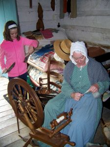 Carding wool and spinning it into yarn