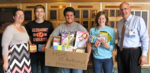The Altamont High School Student Council recently collected over 380 items including mini hand sanitizer, individual packs of kleenex, coloring books and crayons to donate to pediatric patients at HSHS St. Anthony's Memorial Hospital. Shown with some of the items donated are (left to right) are Teresa Lee, Special Education teacher and Student Council/Senior Class Advisor at Altamont High School, and students Hayden Voelker, Austin Wendling, and Brooke Stuckemeyer, along with Michael Wall, St. Anthony's Director of Philanthropy.