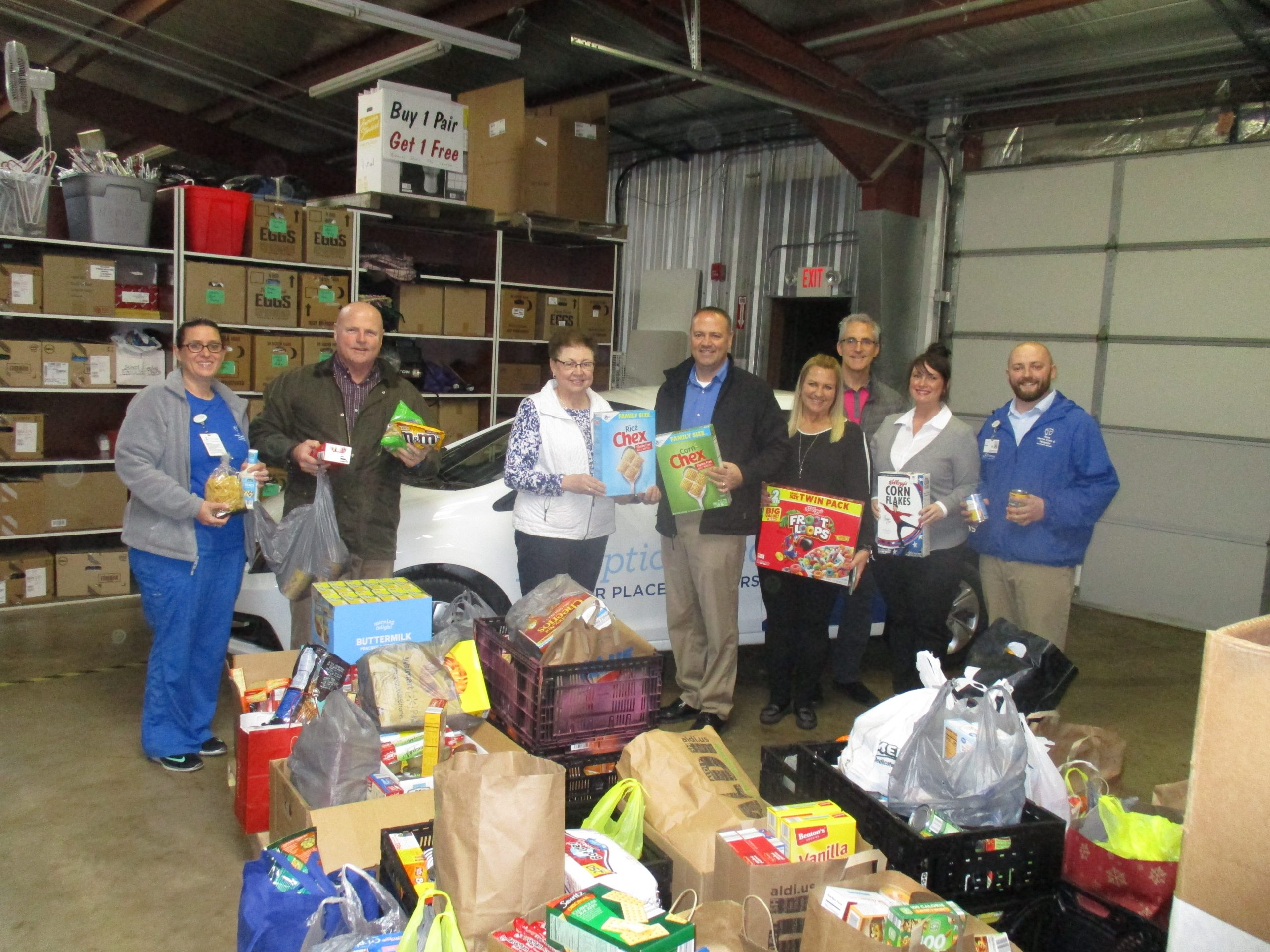 """HSHS Home Care and Hospice """"Crams the Car"""" with Canned Goods for Catholic Charities"""
