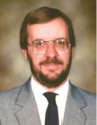 David E. Robards, 65