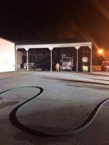Fire crews investigate the source a fire at NOVA Office Furniture Monday night.