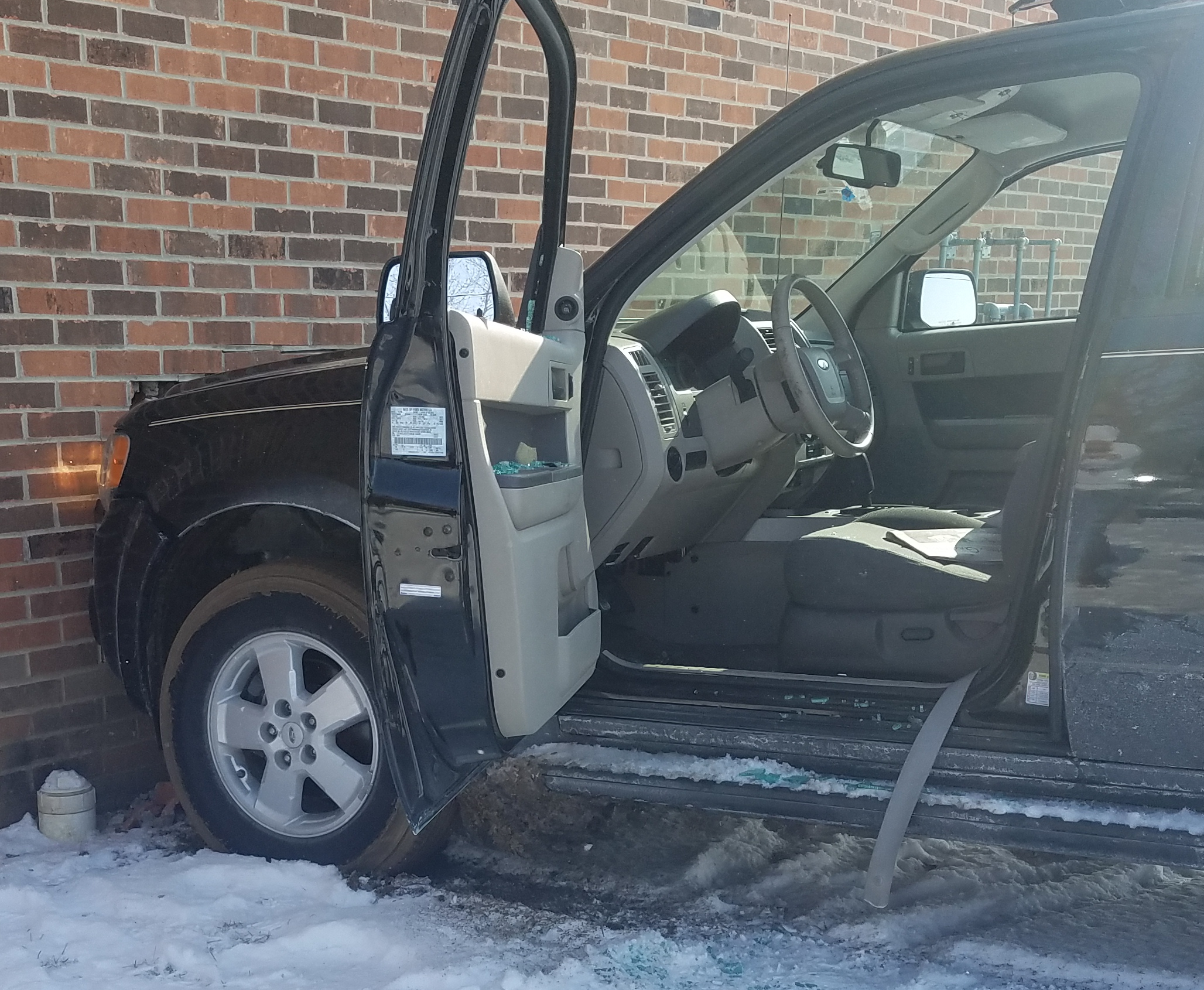 BREAKING: Man Drives into Apartment Complex.