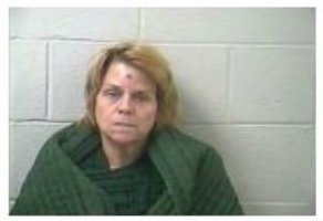 Woman Arrested After Collision With Home
