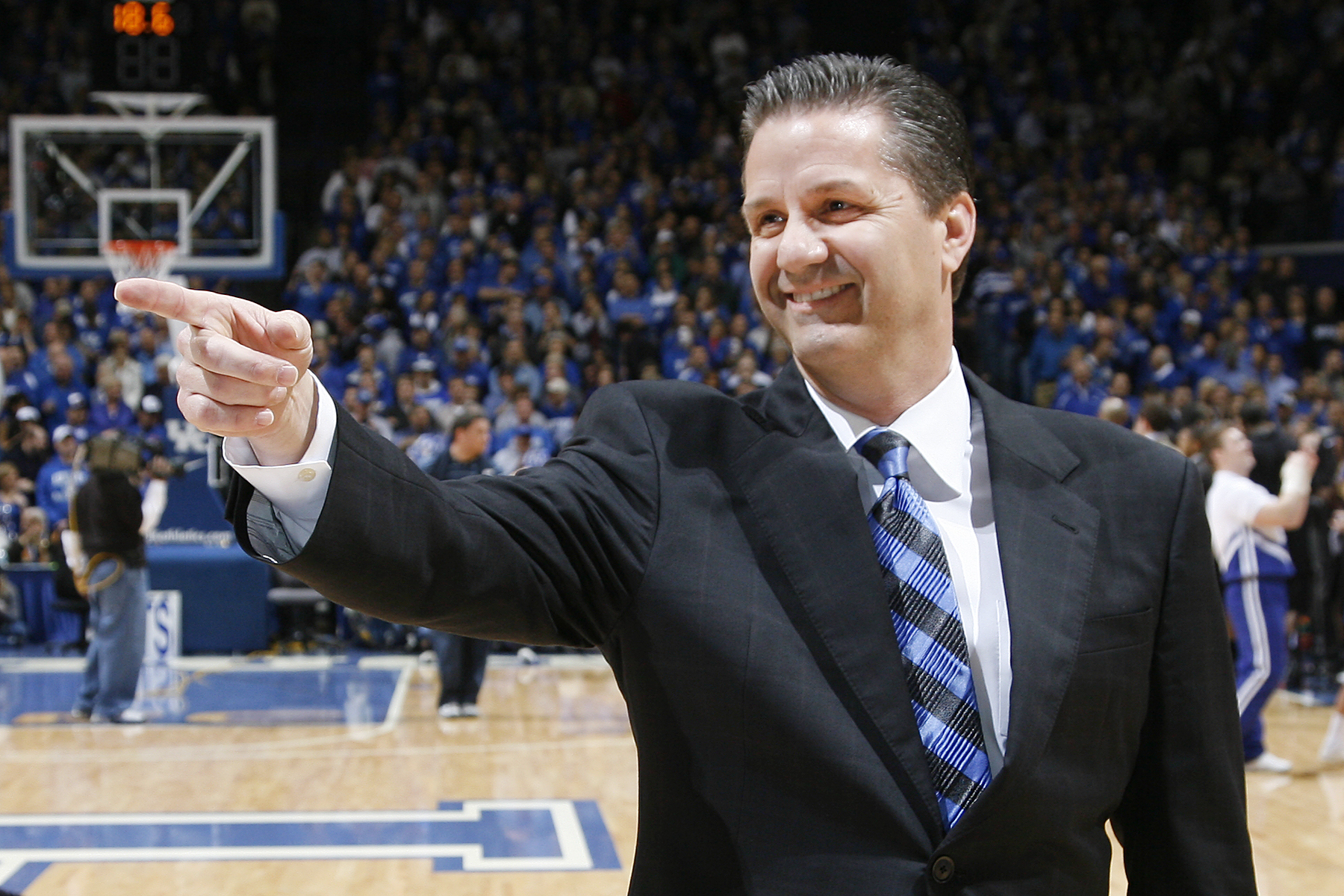 COACH CAL SAYS EVERYONE UNSURE WHERE COLLEGE SCANDAL WILL LEAD