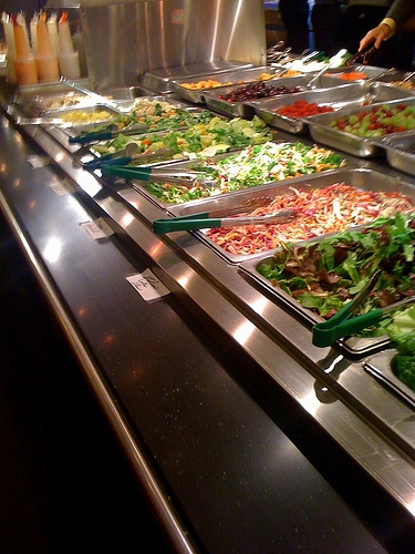 Woman Using Hands to Make Salad at Salad Bar, Punches an Off-Duty Cop for Criticizing Her