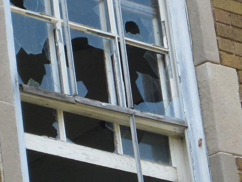A Burglar is Caught When He Gets Stuck in a Second-Floor Window
