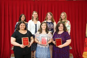 At the Lake Land College Student Recognition Banquet, seven students received the Outstanding Student Award for their academic division. In the back row, from left are: Carley Travis, Agriculture; Ashlee Burton, Humanities and Communications; Kaitlin Slifer, Business; Andrea Speece, Allied Health; in the front row, from left are: Michelle Janes, Technology; Jessie Macklin, Math and Science; Cassandra Eilers, Social Science and Education.
