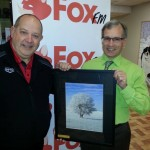 Bruce Thurston (Yorkton Coop gas bars) and Ross Fisher display a one-of-a-kind print given away as a prize for donations!
