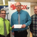 Ryan Hoffman with Collins Barrow just brought by an $2,800 donation for FoxFM's Airwaves for Heath Radiothon!