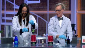 Here he is doing science stuff with Steve Aoki.